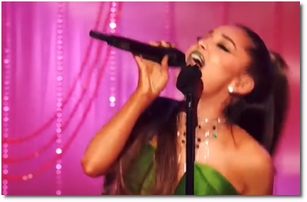 Ariana dips down to the mic stand and grunts near the end of the Wizard and I (at t=3:37, 29 Oct 2018).