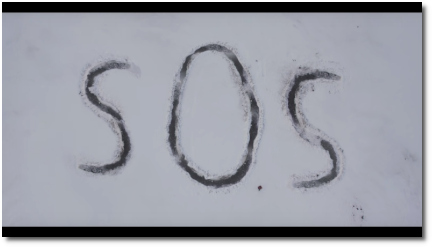SOS written in the snow from the film Arctic (1 Feb 2019)