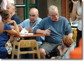 Phillip Seymour Hoffman talks to boy in stroller