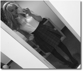 Dove Cameron in crisp schoolgirl fashion