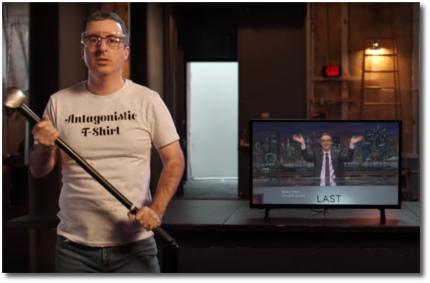 John Oliver wielding a sledgehammer