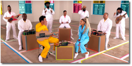 Ariana in light-blue jumper with Jimmy Fallon in yellow
